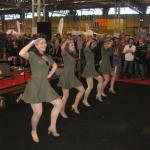 Swing dancers draw a crowd as they warm up at the hot rod and Americana display.