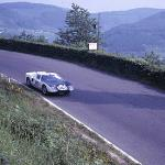Phil Hill racing the new Ford GT40 at Nurburgring in 1964, in a photo by Raymond Burk.