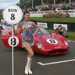 A 1960's model in a Carnaby Street mini-dress holds the 10th row marker for the $5 million Ferrari 250LM behind her.