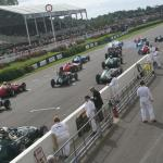 1950's Grand Prix cars roar off in front of the grandstands at the start of the Richmond Trophy race.