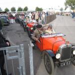 A lineup of Ulsters - probably the most desirable Austin Seven model - prepares for a parade lap.
