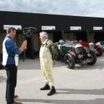 Stanley Mann being interviewed in front of his 1929 Bentley 4 1/2-Litre 'Le Mans'