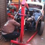 Sally works on getting the engine installed.