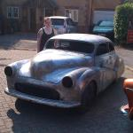 A front view of the metal work with the Morris Minor's proud owner, Sally.