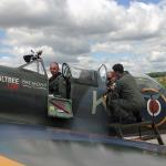Ex-RAF pilot Jim Schofield waits while the passenger is strapped in.