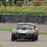 Jason Wright three- wheel drifts the Cobra. (photo- S. Mosley)