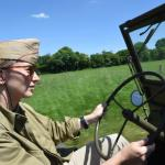 One of our colleagues, Lyn Woodward, takes a turn at the jeep's tiller in the fields north of Saint-Come-du-Mont where paratroopers landed in the early hours of June 6, 1944