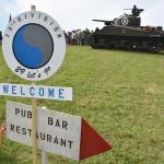 Re-enactment camp at Vierville-sur-Mer; real M4 Sherman tank and the offer of a grilled saucisse and frites