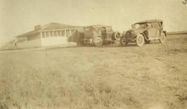 The travelers set up camp in Baker, Mont. The Case Six is in the foreground.