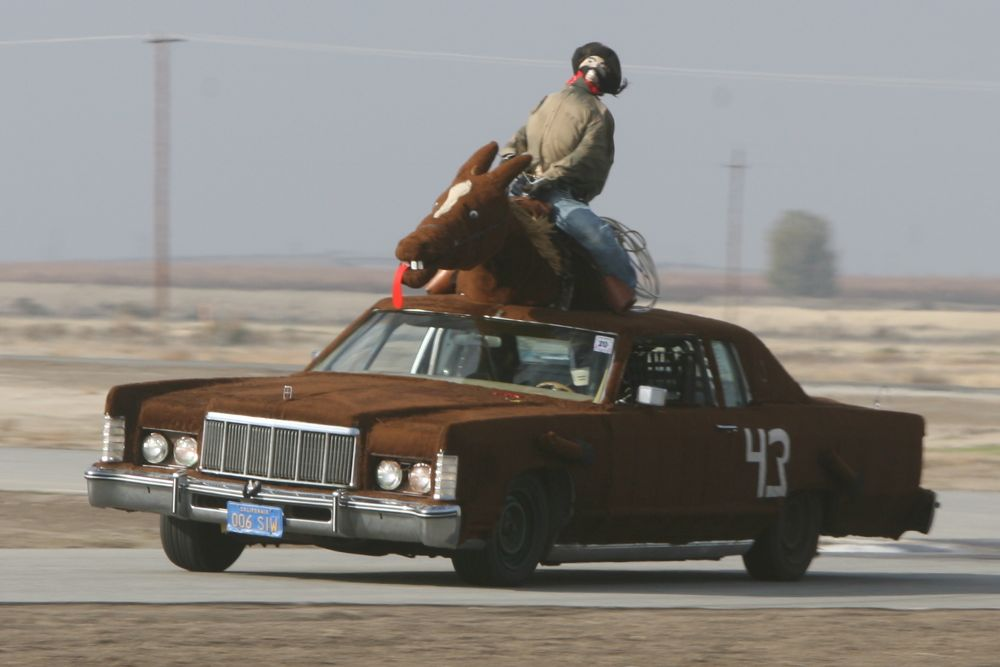 Phony Express' 1975 Lincoln Continental Town Coupe has been converted into a terrifying representation of a horse and cowboy rider.