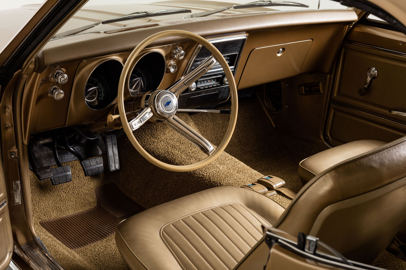 The interior has been restored to the original gold finish. The transmission is a three-speed manual with a column shift.