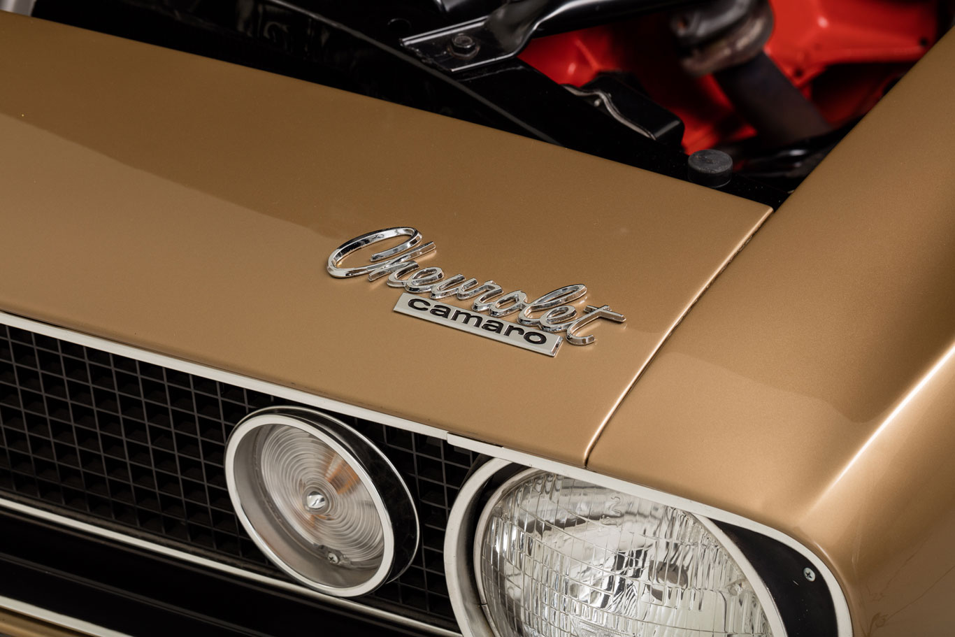 The exterior is Granada Gold. Chevrolet did not finalize the Camaro model name until very late in the game.