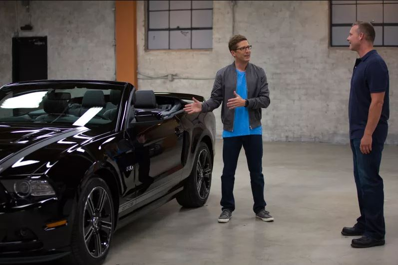 Spike Feresten showing off a Mustang on Car Matchmaker