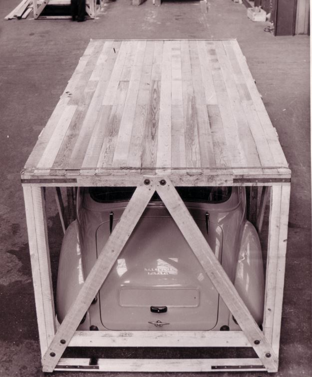 A wooden-crated Morris Minor awaits shipment from Great Britain to Vancouver, B.C., in 1957