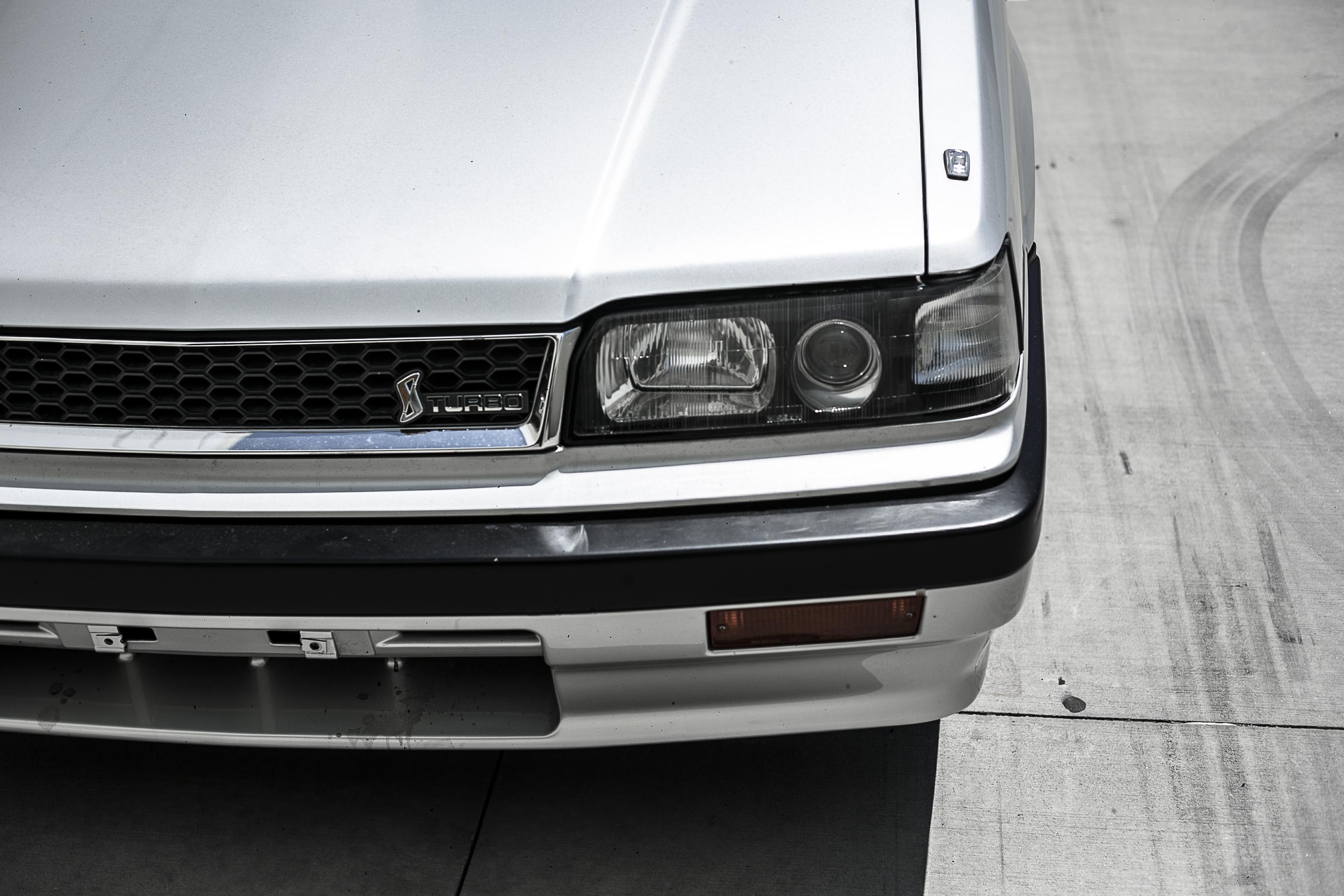 Nissan R31 Skyline turbo wagon headlight detail