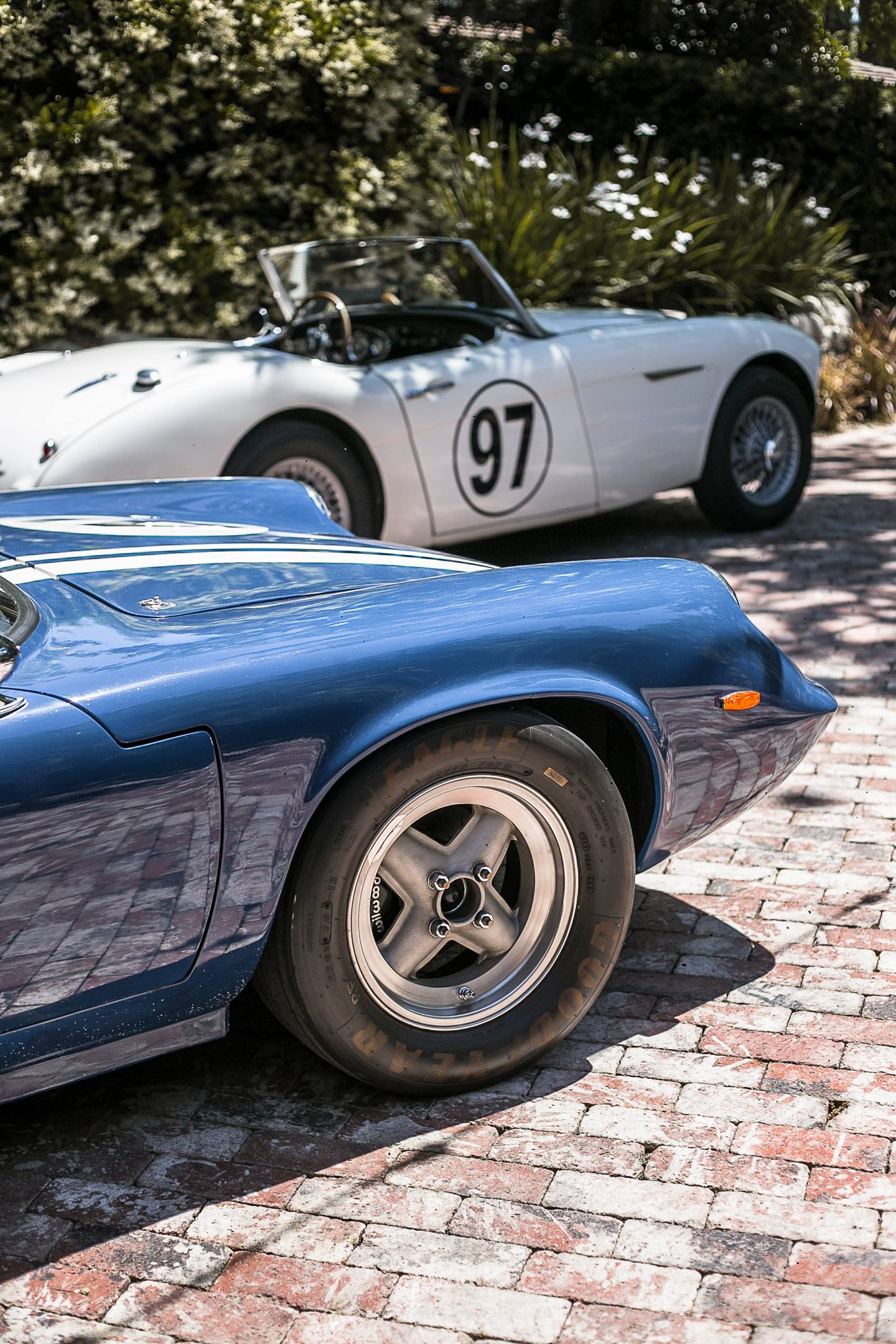 A 1970 Lotus Europa and and a 1960 Austin-Healey 3000 MkI. detail
