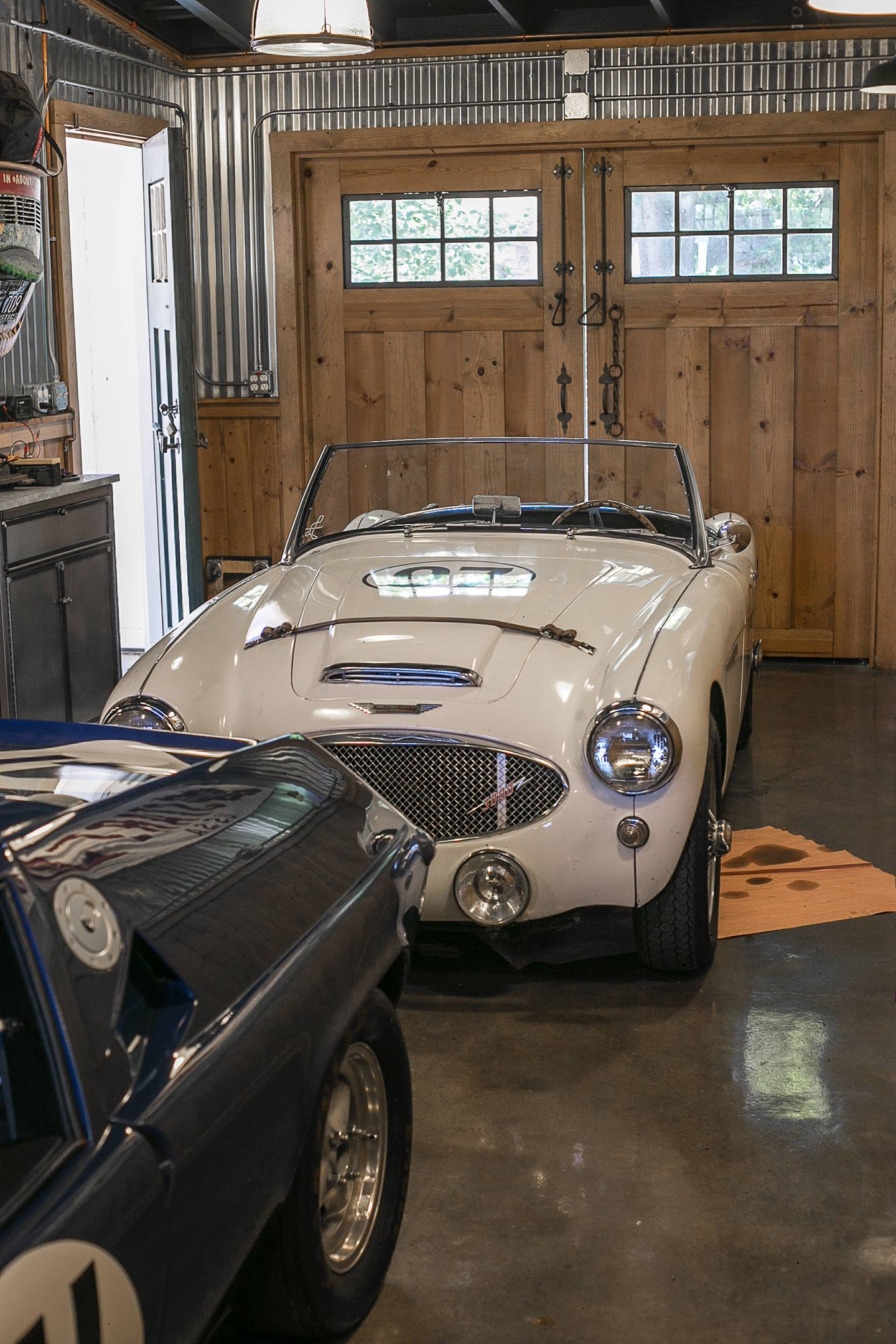 A 1960 Austin-Healey 3000 MkI and a 1970 Lotus Europa at the Caccavo garage in Thousand Oaks, California.