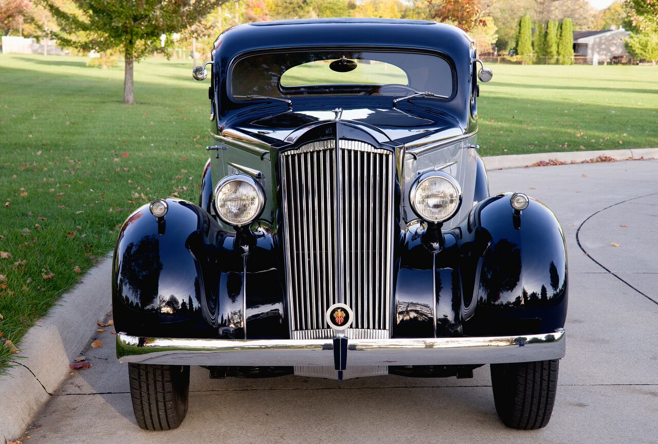 The 120's classic Packard grille and beautifully contoured fenders qualify as automotive art.