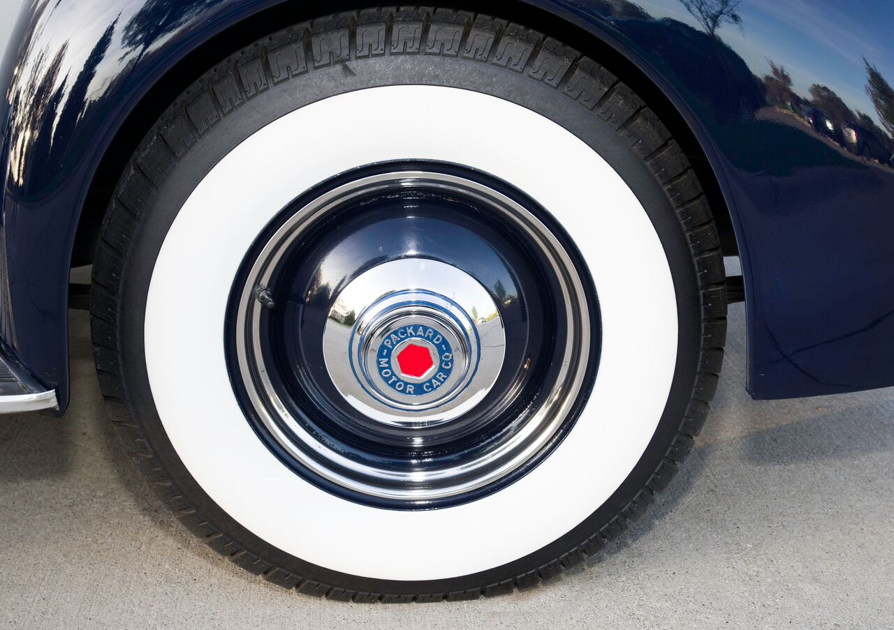 Radial reproduction tires ride on the Packard's narrow 16-inch wheels.