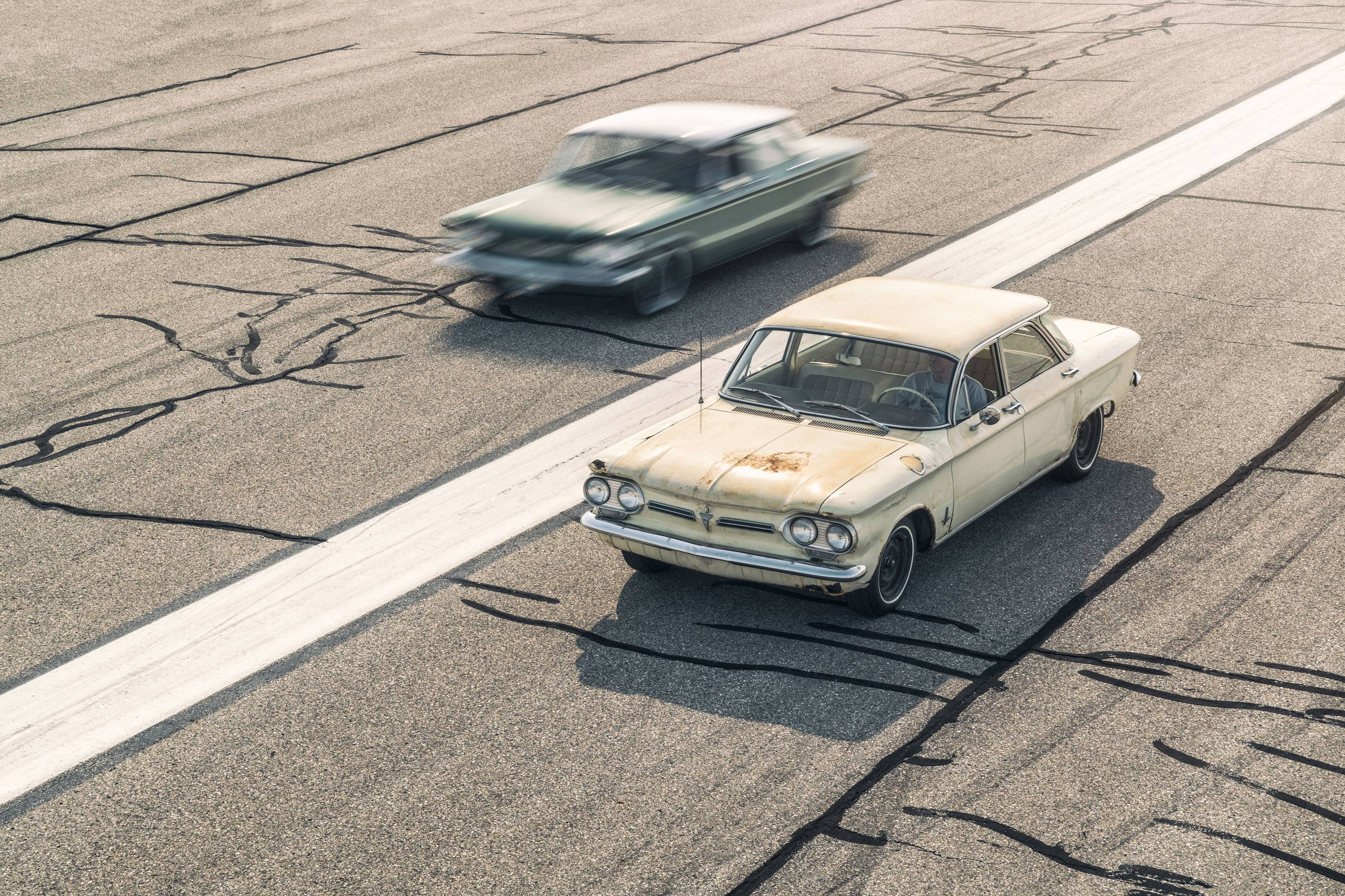 Ralph Nader's '62 Corvair monza driving next to a '60 Corvair