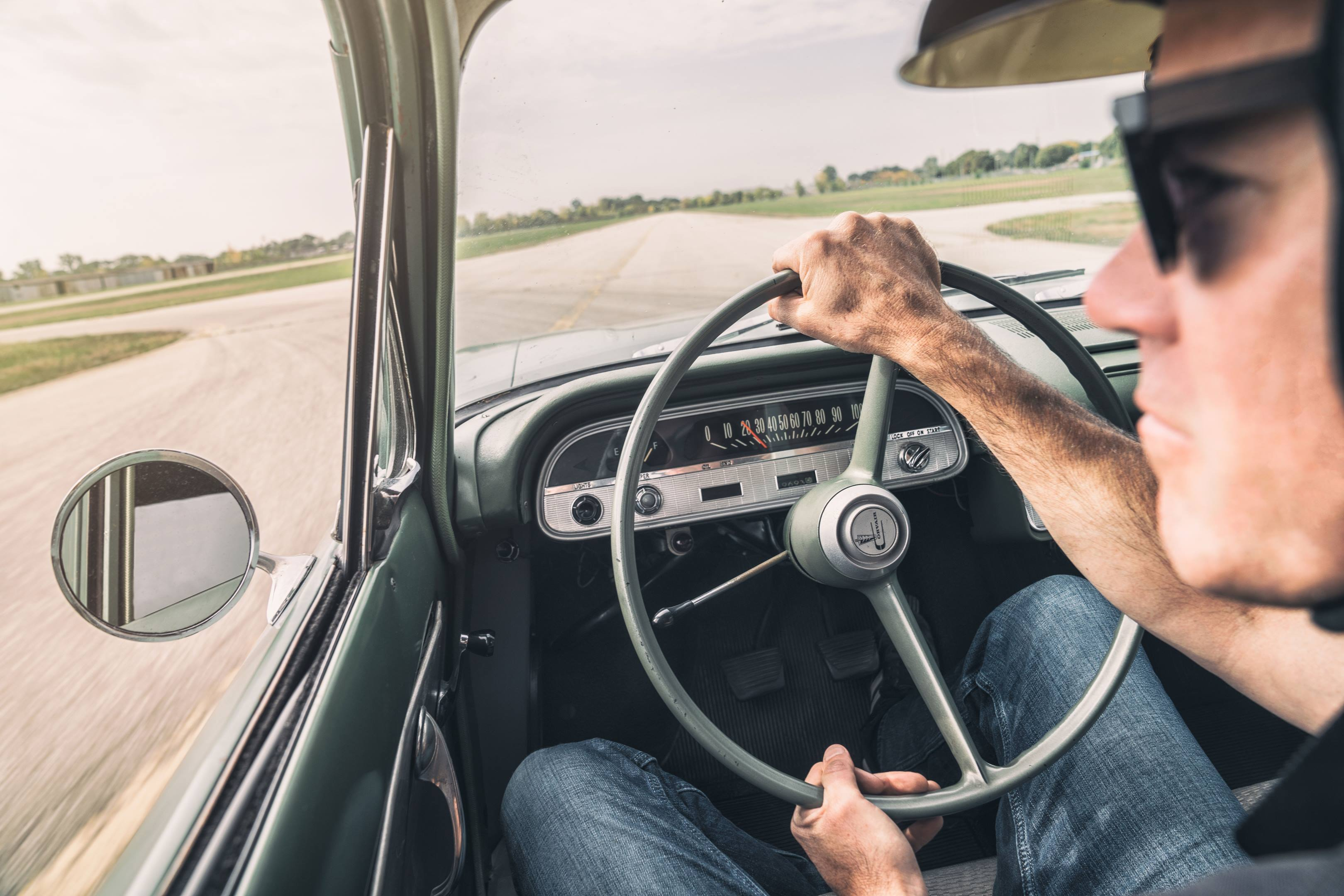 behind the wheel of a 1960 Corvair