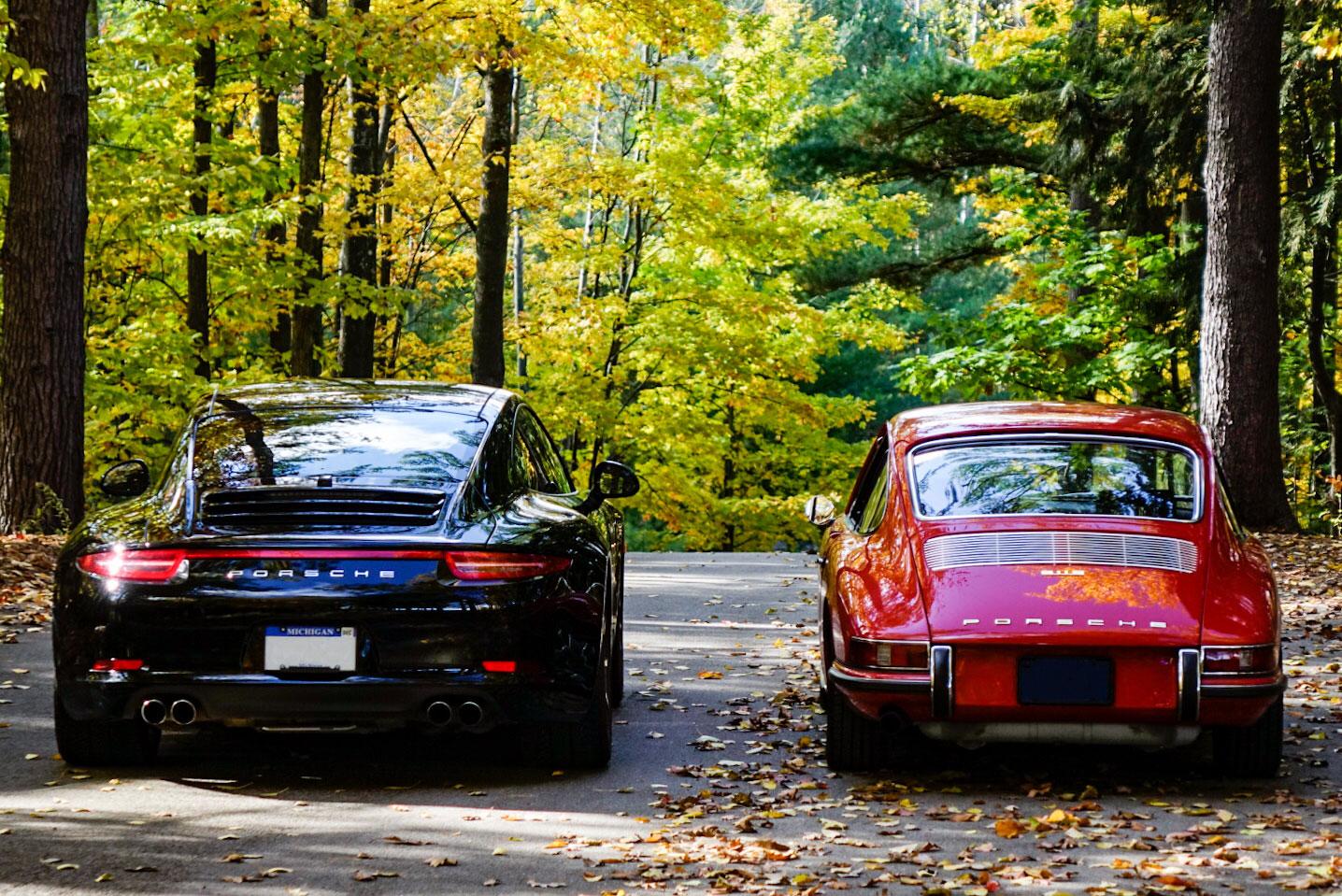 1967 Porsche 911S and 2013 Porsche 911 Carrera 4S rear