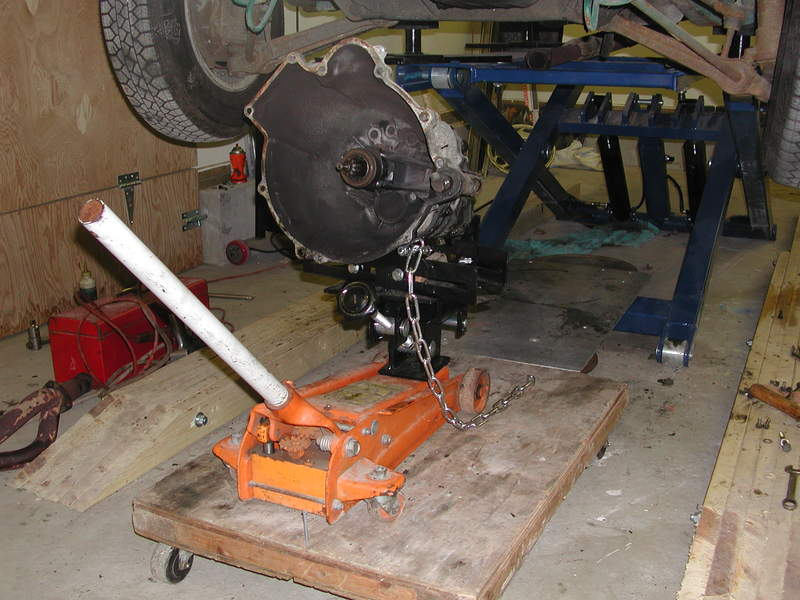 A piece of sheet aluminum laid on top of them to act as a floor over the brace between the mid-rise's legs on which to roll a transmission jack.