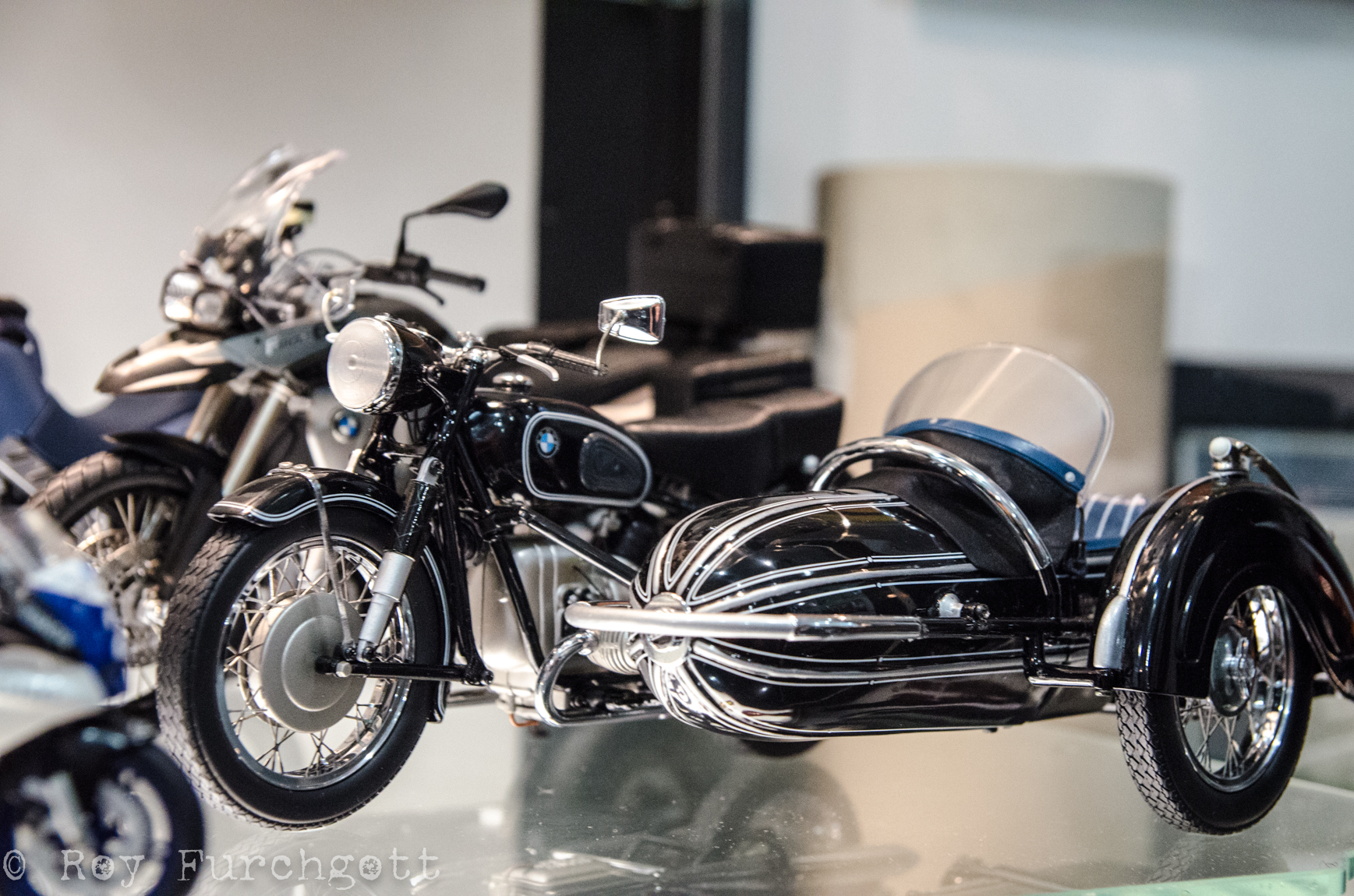 Some miniature BMW sidecars are among Henig's garage showcase of collectibles.
