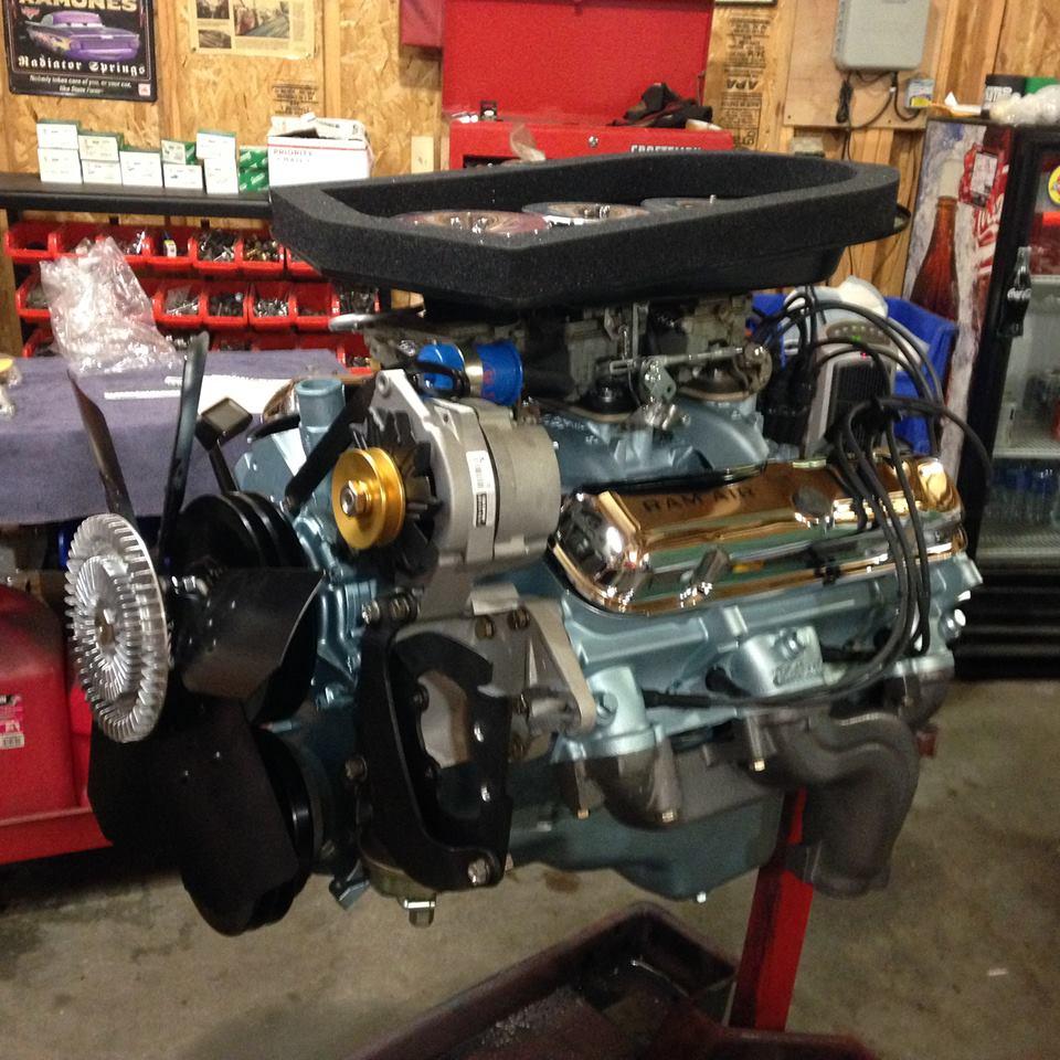 Motor out of a 1965 Pontiac GTO Tri Power