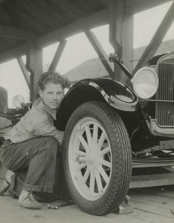 an Edison Institute student working on a Model T