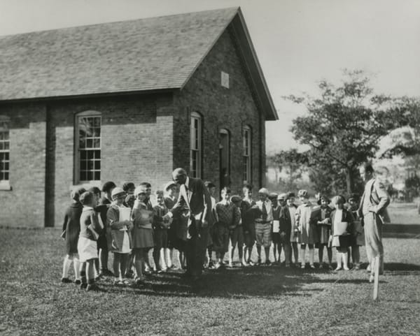 Henry Ford meeting students outside of the Edison Institute