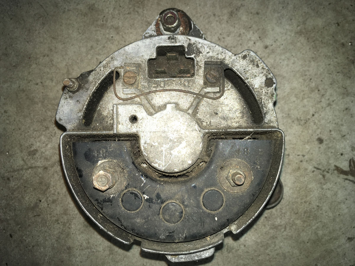 The back of a 1970s era Bosch alternator with its battery (B+) and regulator (D+, D-, and DF) connections