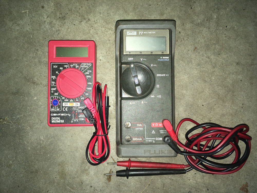 The Harbor Freight $5.99 multimeter (left) does not have autoranging, and consequently, its center selection dial is cluttered with options. In contrast, any autoranging multimeter (right) has a much simpler dial.