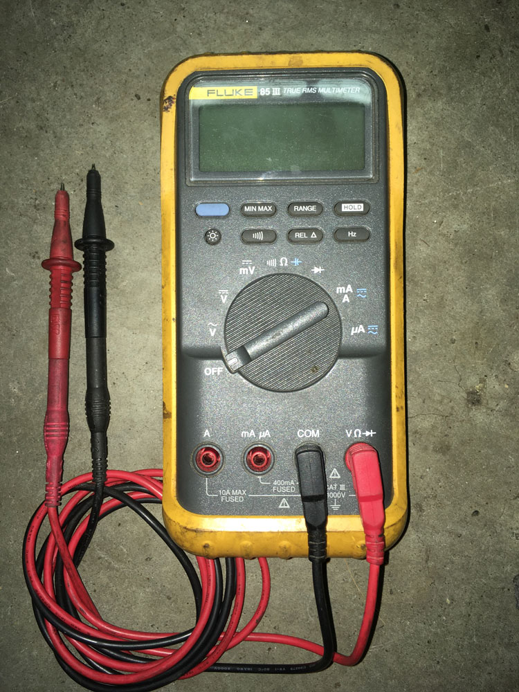 The familiar layout of a multimeter with display, option buttons, rotary dial, and plug sockets