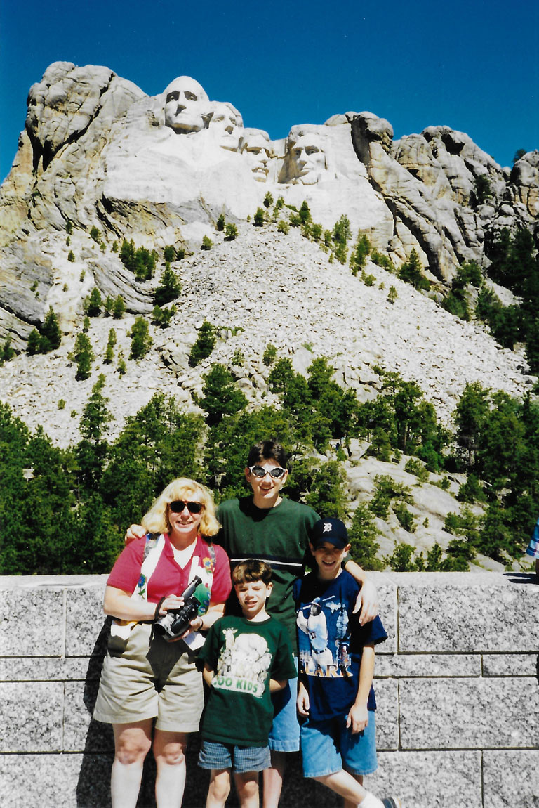 Nick Gravlin with his family in front of Mount Rushmore