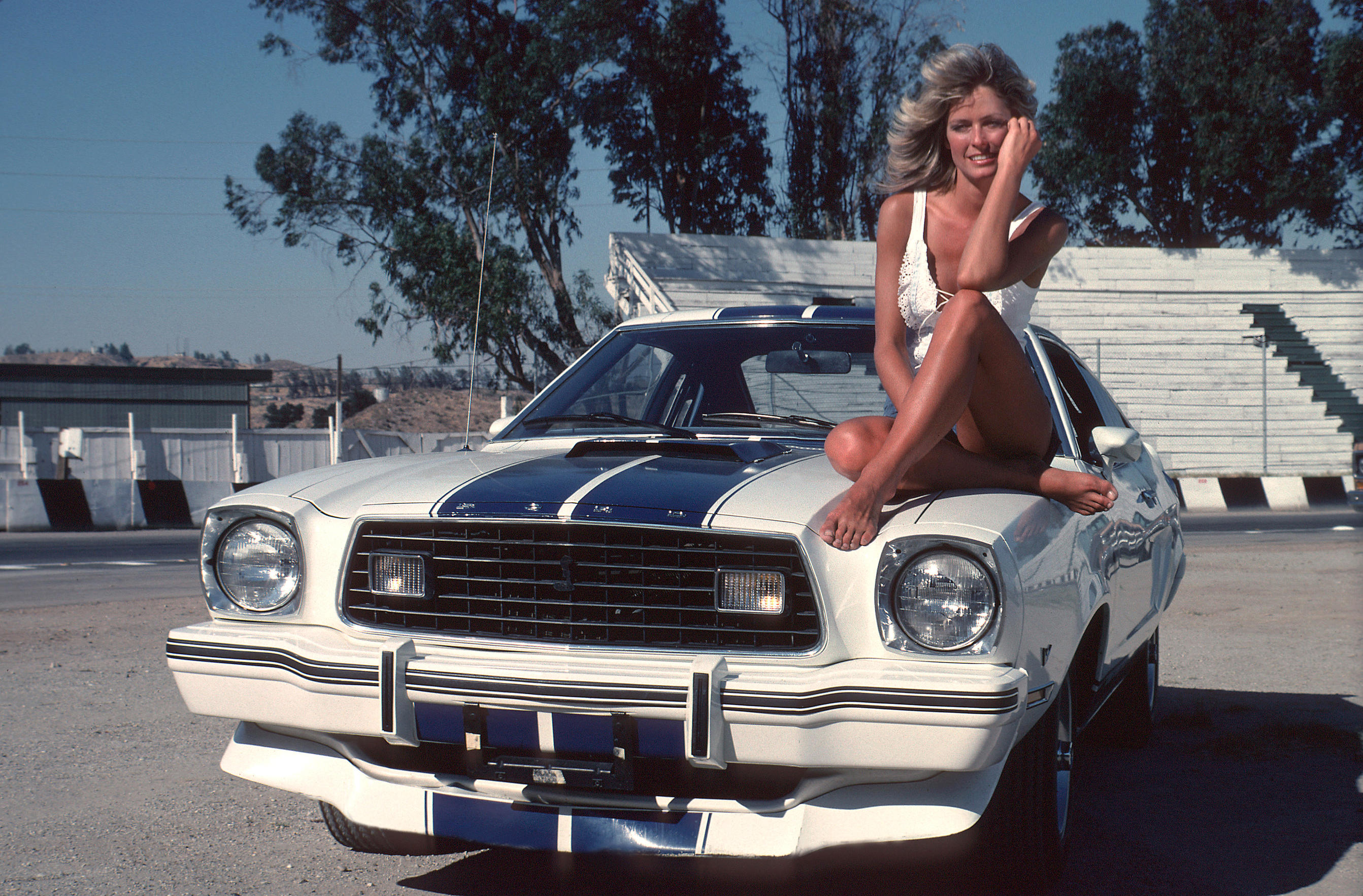 Farrah Fawcett sitting on the 1976 Ford Mustang Cobra II from Charlie's Angels