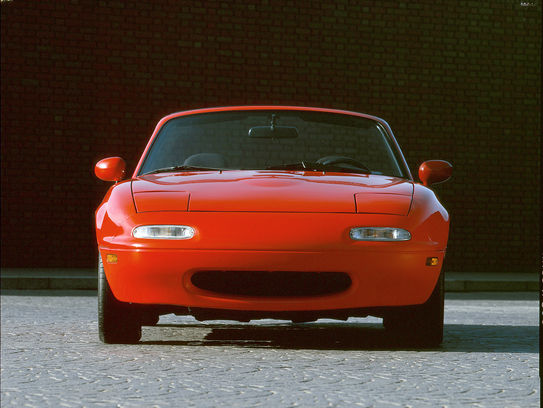 1990 mazda mx5 miata red front