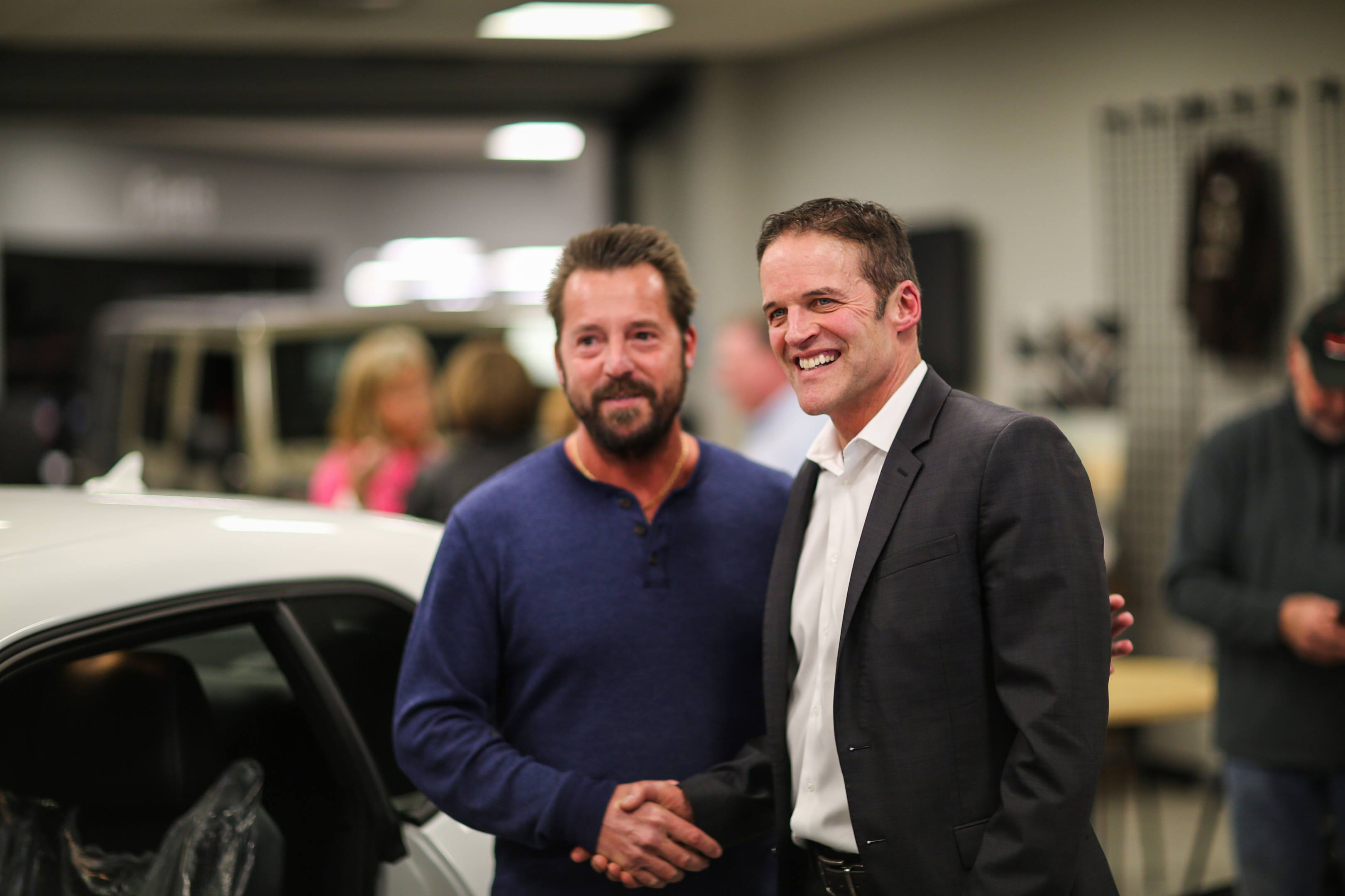 Bill Marsh Jr. (right) congratulates Ted Parrott.