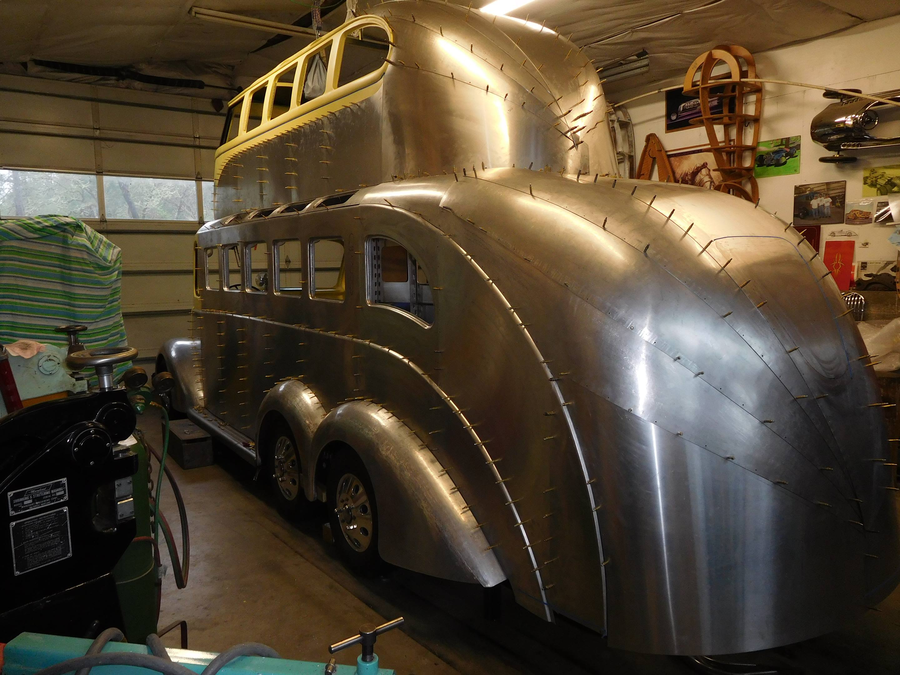 Randy Grubb began this project just over a year ago, and the latest photos show the tremendous progress that has been made. The VW Bus incorporated into the roof began as an 11-window model, but it has since been converted into a more Samba-like configuration with an upper row of windows. The new aluminum skin on the side and tapered tail show the lapped construction method.