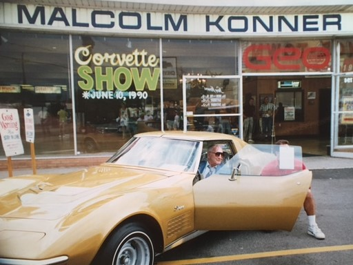 Zora Arkus-Duntov poses with a Corvette fan at Malcolm Konner Chevrolet in 1990.