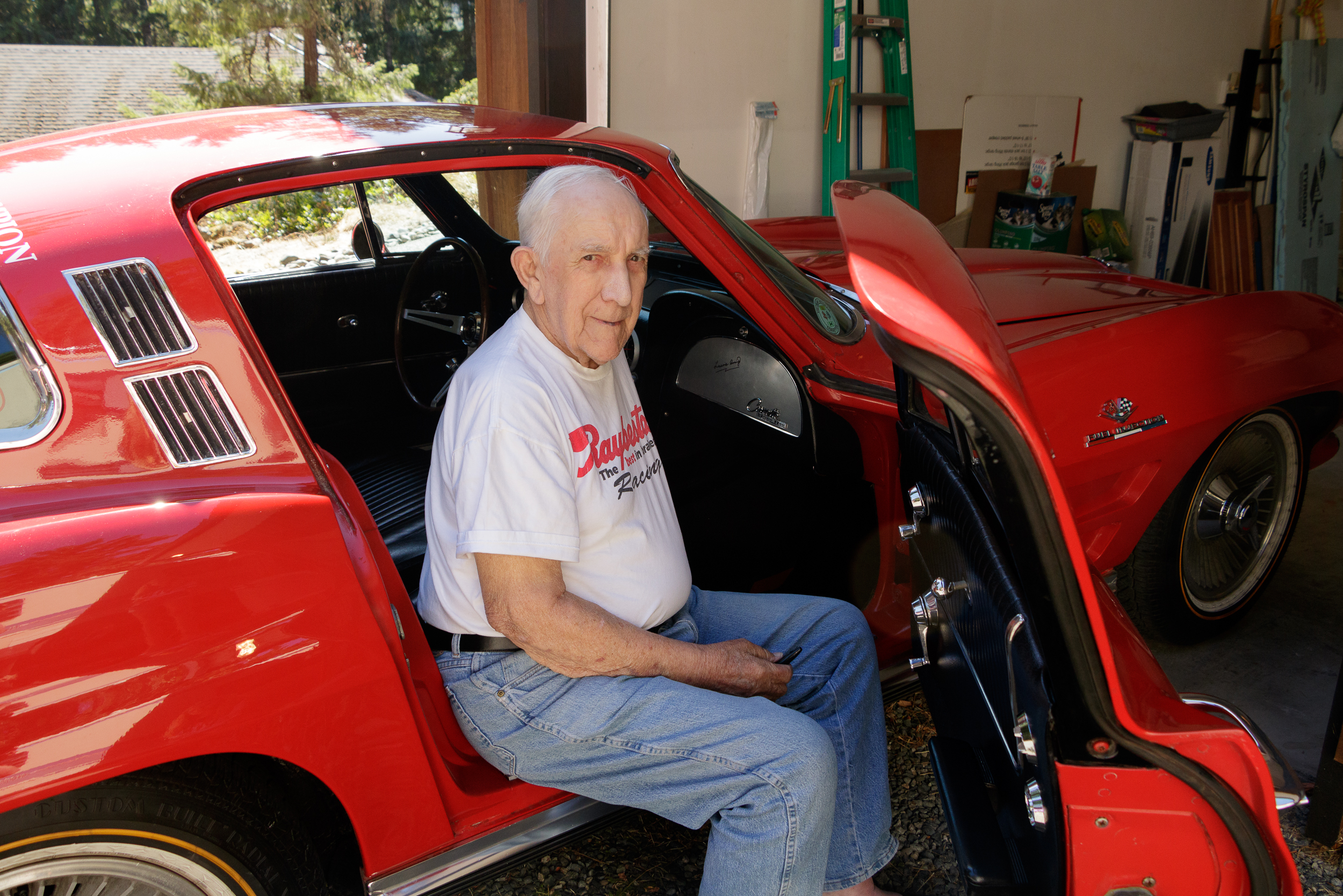 Laurie Craig sitting in the 1964 Chevrolet Corvette