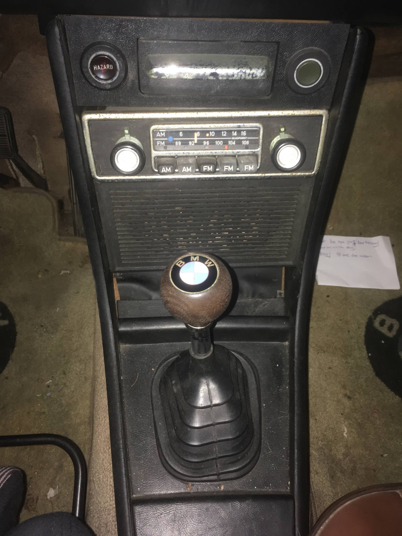 Even a beat-up original radio adds to the authentic landscape of a vintage car's interior.
