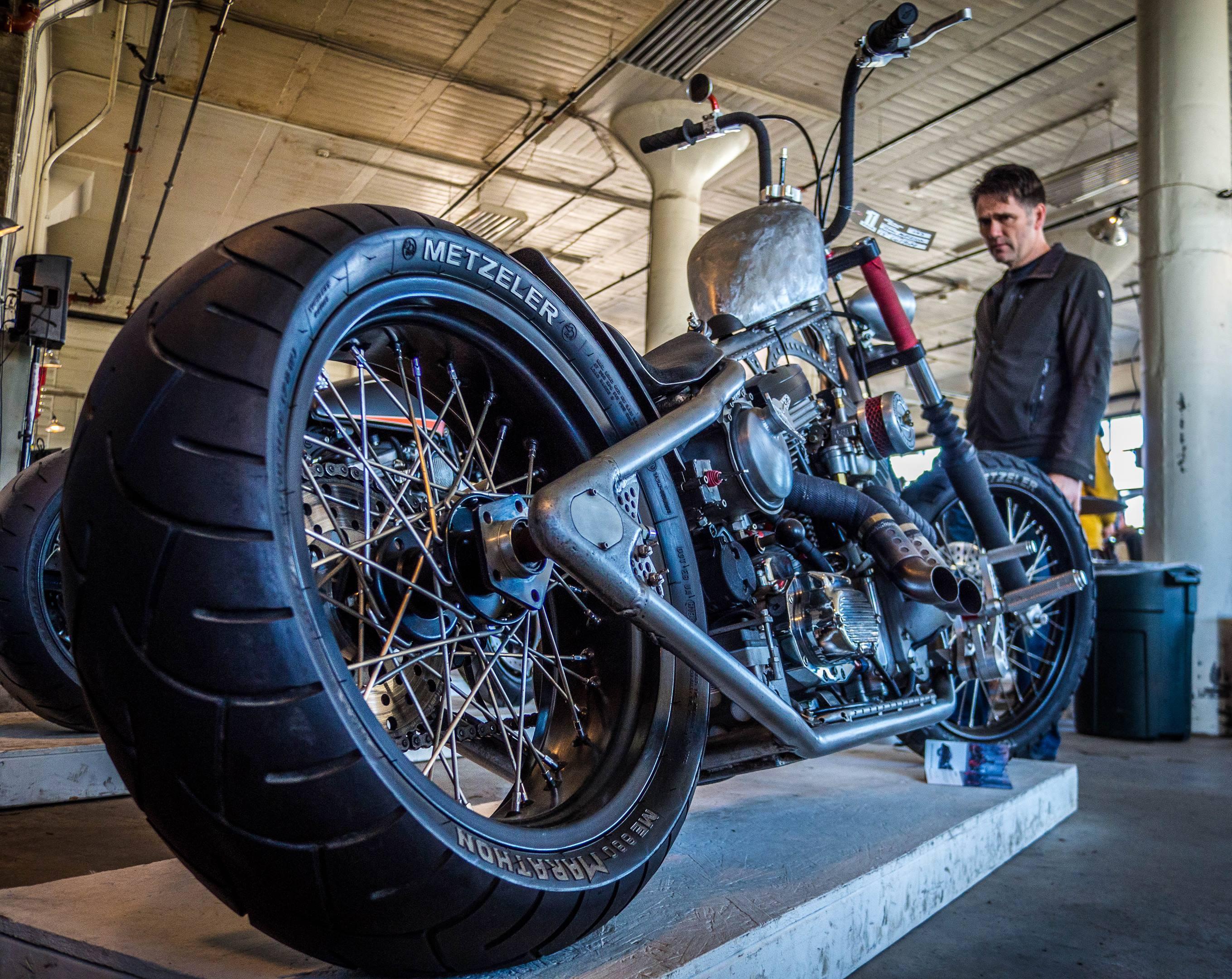 A full custom with a fatty boombalatty rear tire, built by John Aleckson.