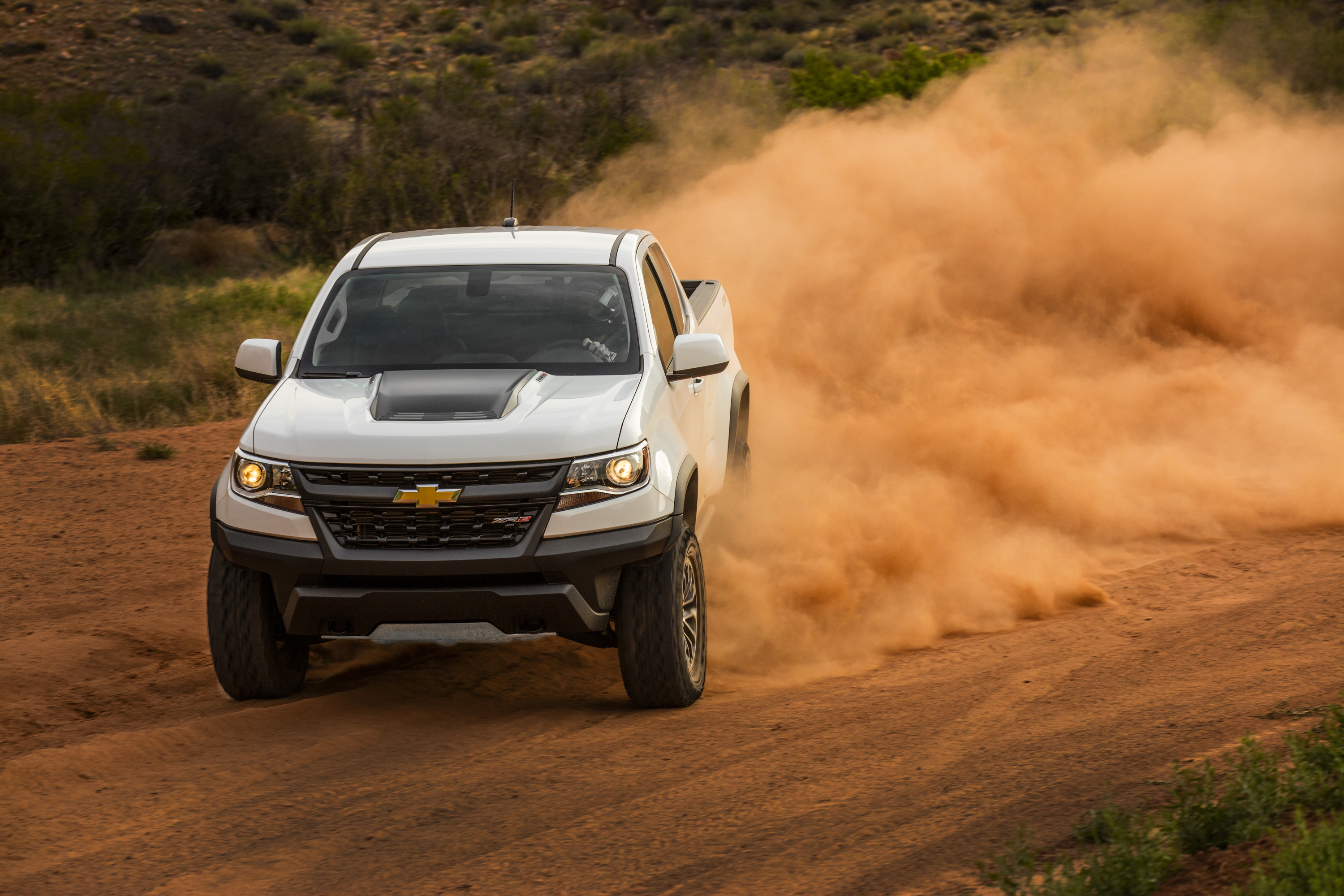 A white 2017 Chevrolet Colorado ZR2 on a dirt trail