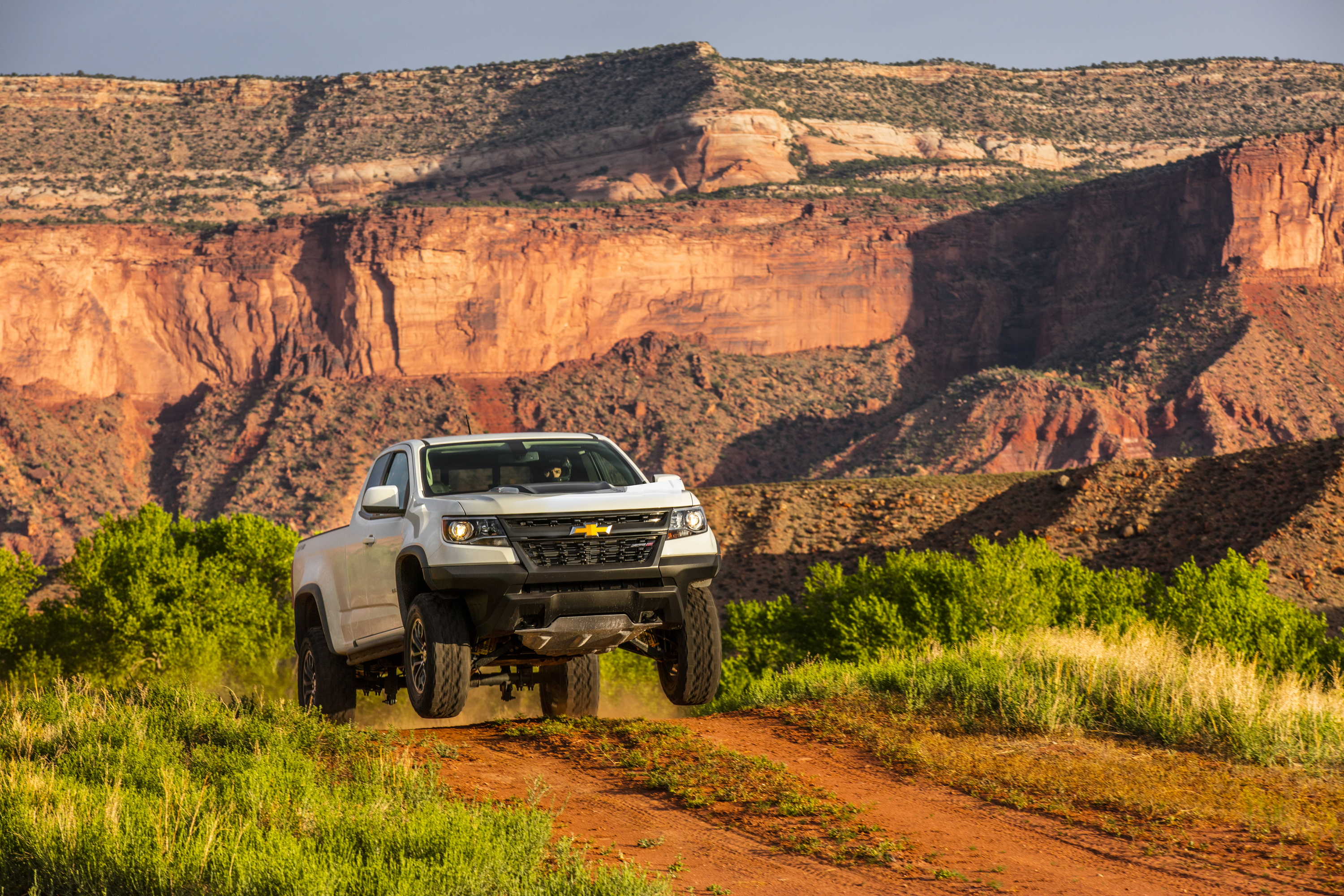 2017 Chevrolet Colorado ZR2 making a jump over a hill
