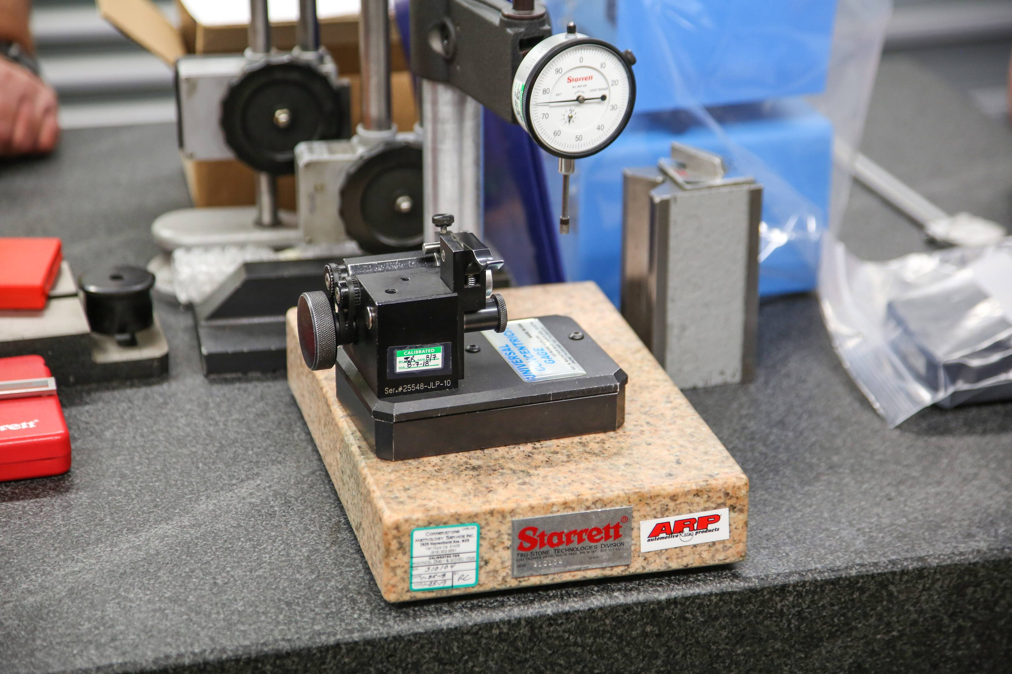 The inspection room is filled with all sorts of measurement tools, from state-of-the-art laser scanners to precision dial indicators like this one.