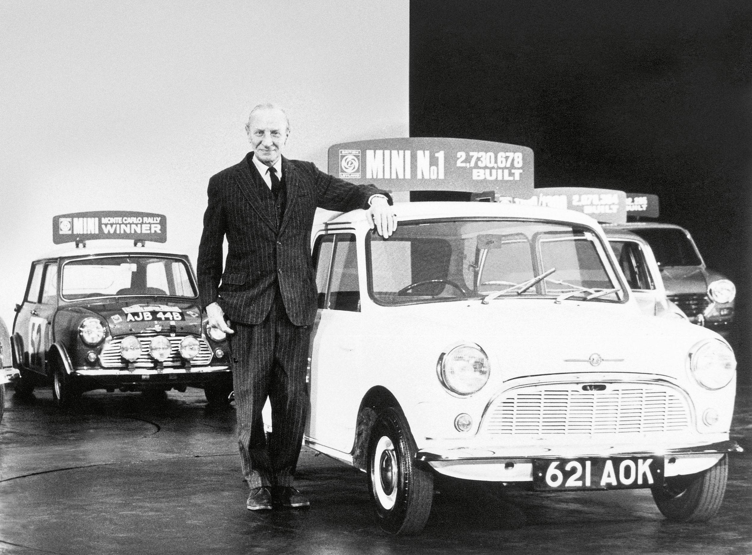 Sir Alex Issigonis standing next to a vintage Mini