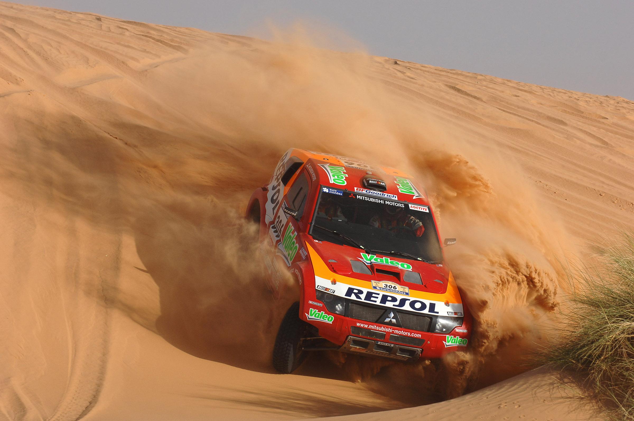 Mitsubishi truck on a sand dune