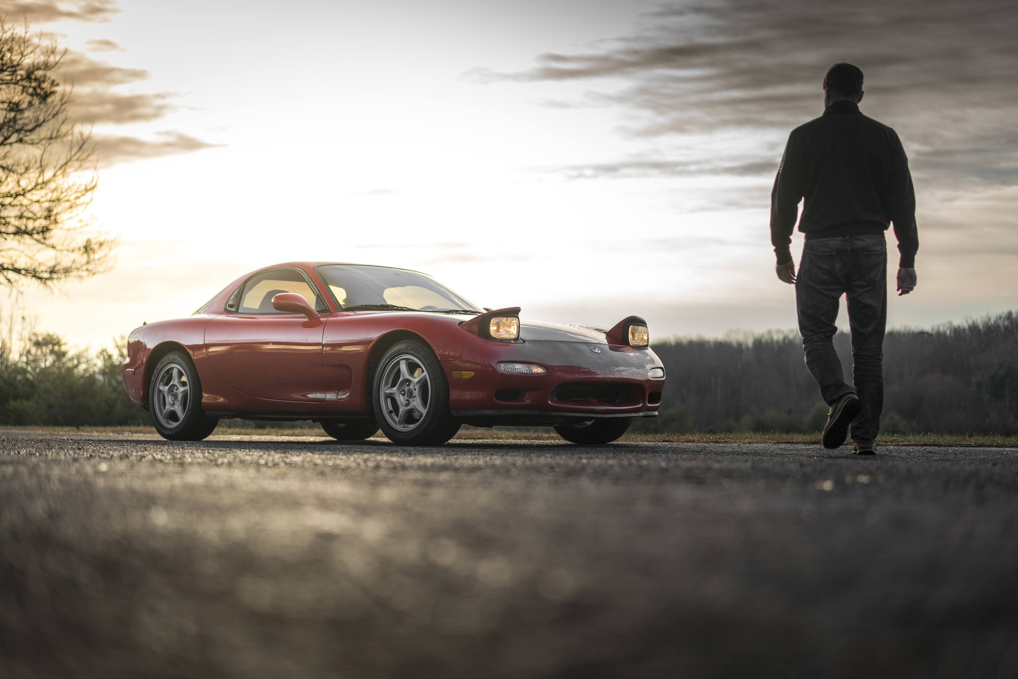 Larry Webster walking towards his 1993 Mazda RX-7 purchase