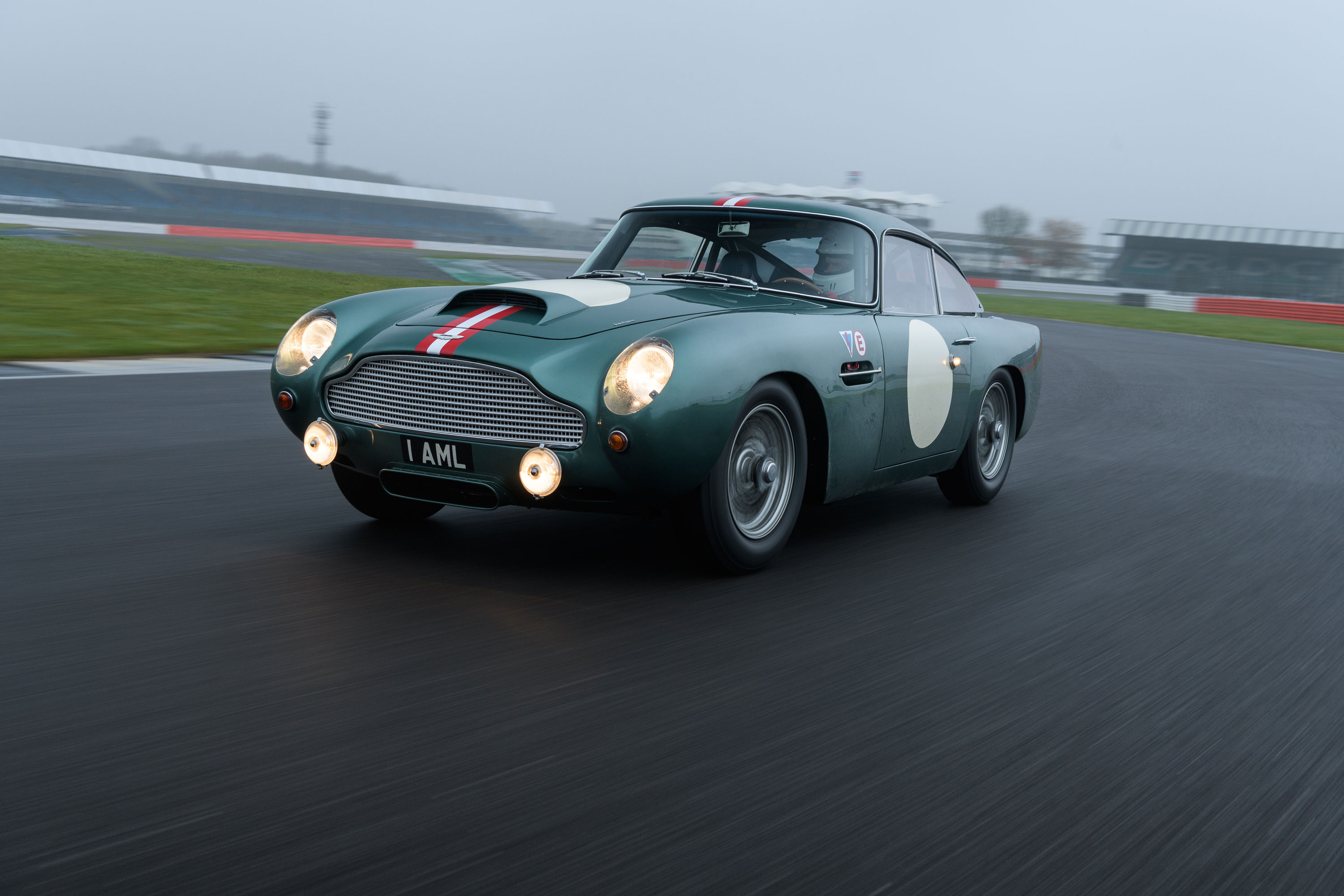 1959 Aston Martin DB4 GT low front 3/4 on the track